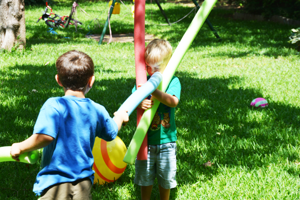 Kids Hitting Each Other With Pool Noodles