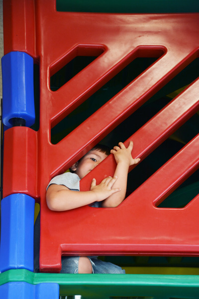 Hiding in the Burger King playground